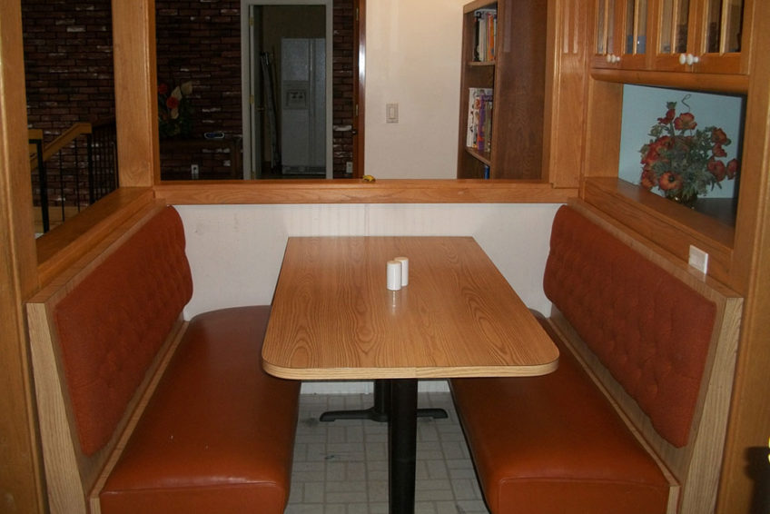 Booth Seating Next to Kitchen Bar Stools -